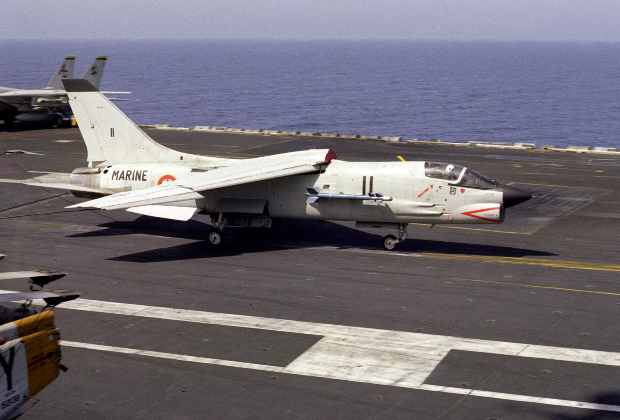 F 8EFN catching wire on USS Eisenhower CVN 69 1983