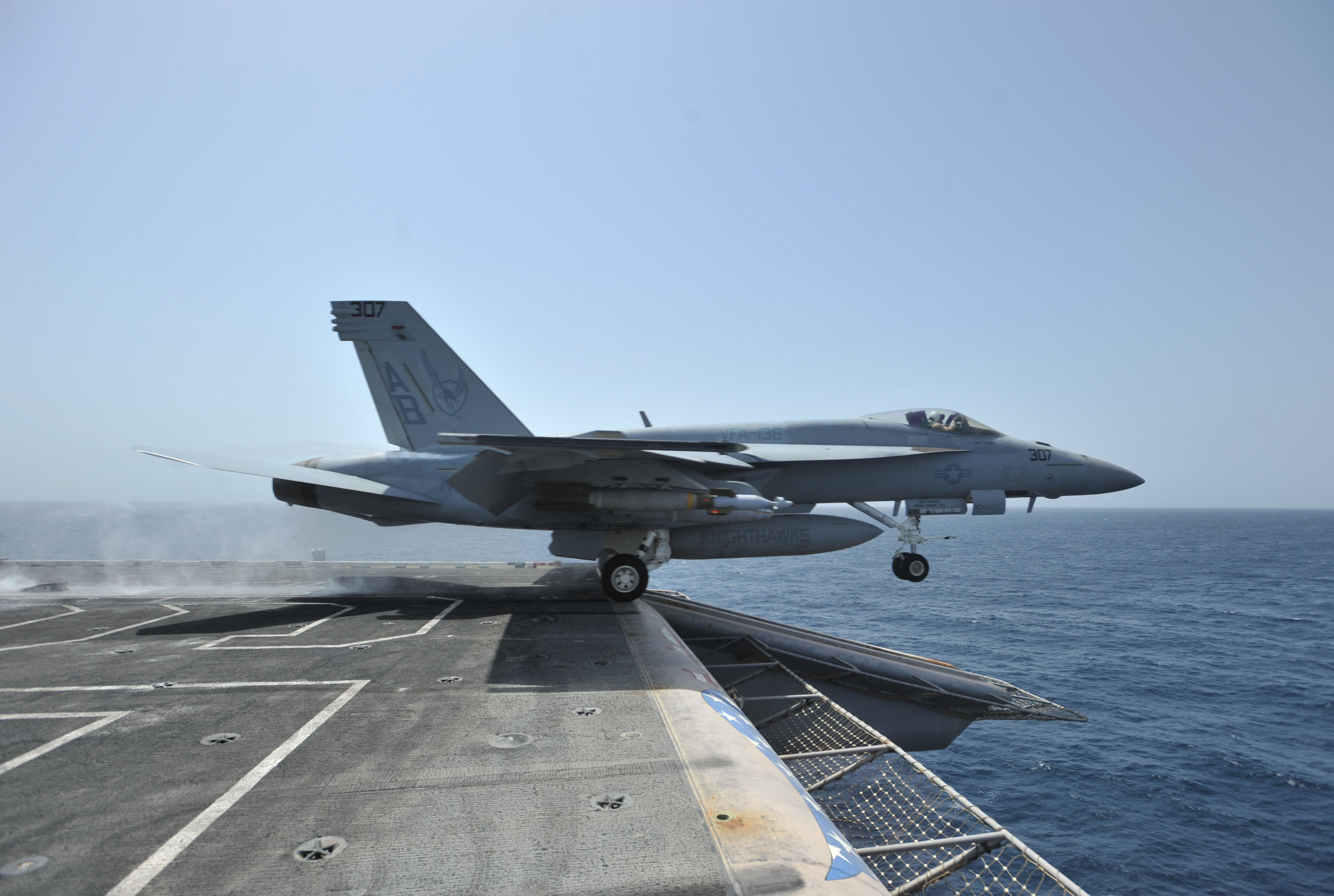 US Navy 110328 N 0569K 105 An F A 18E Super Hornet assigned to the Knighthawks of Strike Fighter Squadron VFA 136 launches from the aircraft carr