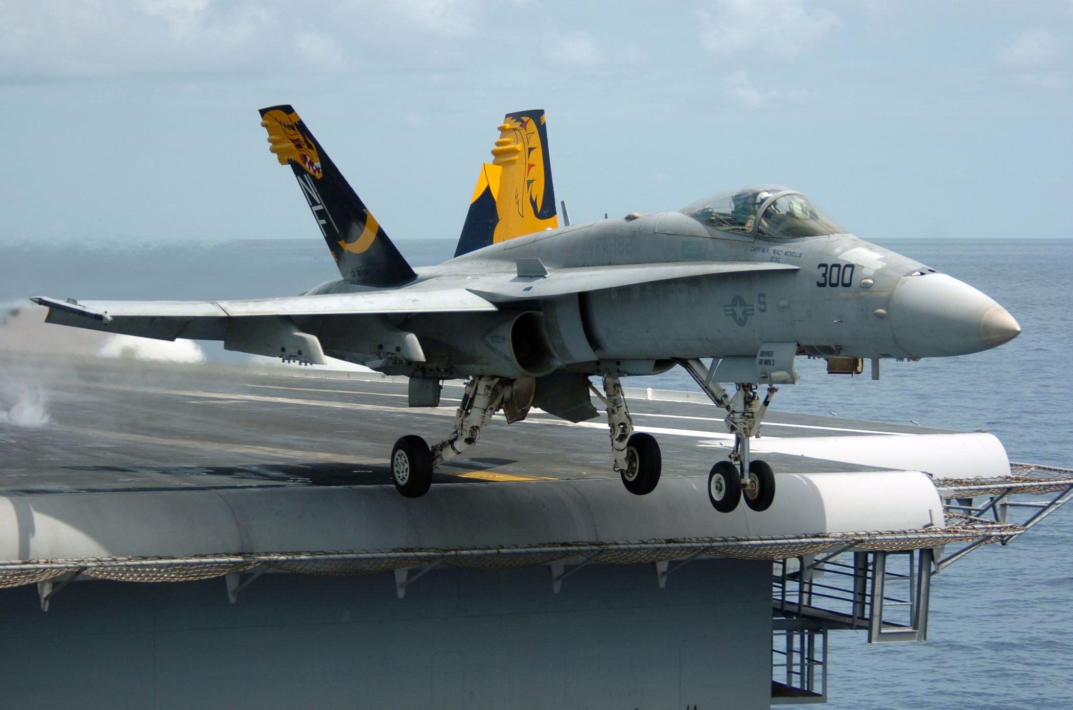 An F A 18C Hornet launches from the flight deck of the conventionally powered aircraft carrier