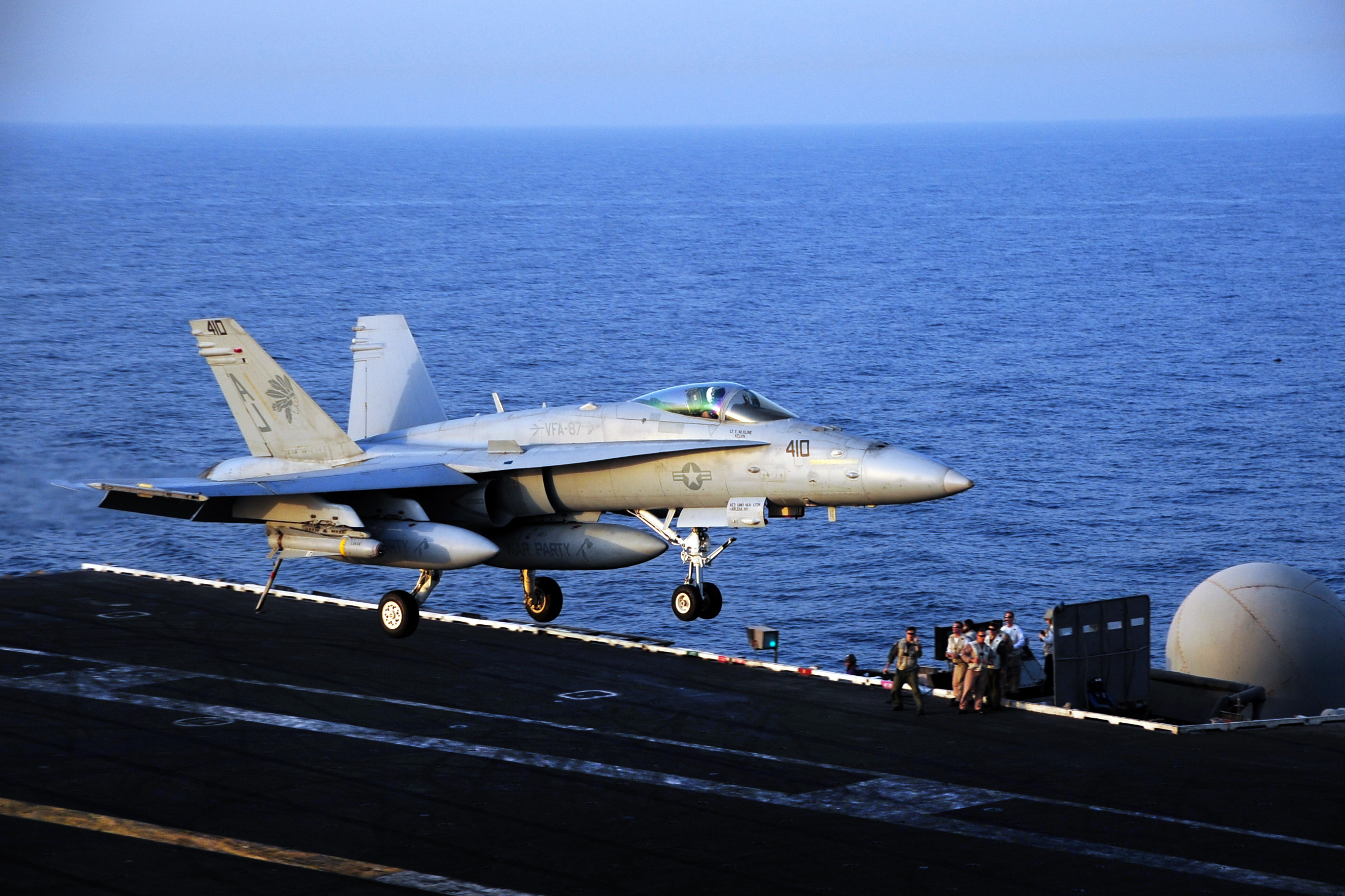 FA 18C Hornet attached to the Golden Warriors of Strike Fighter Squadron VFA 87 lands on the flight deck of the aircraft carrier USS George H.W. Bush CVN 77